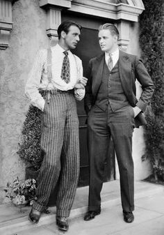 Very good view of 1930's trousers without a jacket or vest being worn over them! Also, check out how short that tie is!