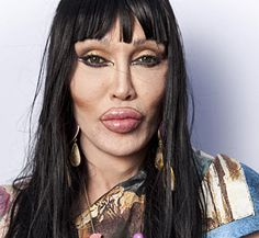 Plastic surgery gone bad... Ya think???  Pete Burns...  front MAN for band Dead or Alive