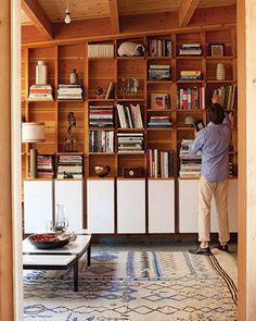 """like the combo of """"hidden"""" storage (ie, behind doors) and open shelves.  i could do without the man with the pretentiously rolled pants, however."""