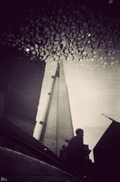gavinhammond The Shard in another puddle.    London through puddles