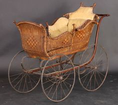 ANTIQUE VICTORIAN RED WICKER PRAM STROLLER...Patricia Baine Roblyer the stroller looked like this.