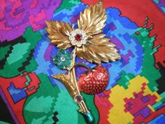 Strawberry on Vine Pin  Brooch Brass with Leaves & Rhinestone Accents  Brass Vintage Antique Jewelry. $25.00, via Etsy.