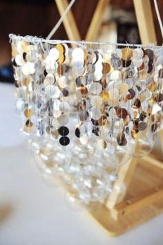 Make Your Own Pretty Handmade Chandelier - Fab You Bliss - DIY Ornament & Sequins Chandelier- I love the strings of sequins on this. Capiz Shell Chandelier, Chandeliers, Chandelier Ideas, Homemade Chandelier, Playhouse Furniture, Vintage Store Displays, Bottle Display, Crafty Craft, Crafting