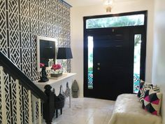 A DIY black and white stenciled entryway accent wall using the Lattice Allover Stencil Pattern from the designer series by Kathy Peterson, Cutting Edge Stencils. http://www.cuttingedgestencils.com/lattice-stencil-pattern-kathy-peterson.html