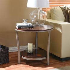 Perk up your home with our Halo Wood and Metal Contemporary End Table-Regular. This discount-furniture item shows that style and price aren't mutually exclusive. Featuring circular cherry-veneer wood ...