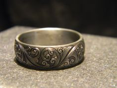 8mm titanium engraved ring with JHook engraving Please call 817-386-5412 or email reads@erath.net for current pricing