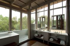 Love this--large walk-in shower, the mirrors, the large windows. Obviously, a private lot would be nice.