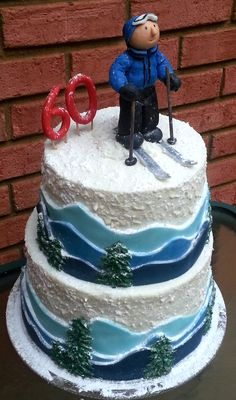 60th birthday ski cake with fondant mountains and dimensional snow and pine trees.  Made by Baking Queen Darlene