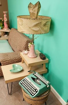 mid century decor ..... We all were so in touch and in the Atomic age, yes we had a typewriter in the living room