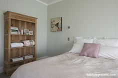 Resene Secrets is an elegant choice for this bedroom, with its classic tongue and groove walls. Project by David Wraight Cottages, photo by Juliet Nicholas. http://www.habitatbyresene.co.nz/kirsty-and-david-set-tone-old-new