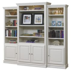 Beautiful bookcase with crown molding and overhead spotlights.