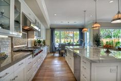 Contemporary Kitchen with European Cabinets, Breakfast nook, Flat panel cabinets, Simple Granite, flush light, Crown molding