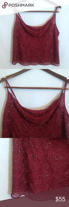 "NWT Newport News Cranberry Silk Beaded Crop Tank NWT Newport News Cranberry Silk Beaded Crop Tank. Size 1X. Includes bag with extra beads & brackets for adjustable spaghetti straps. Fully lined. Beautiful beading on front of top. Soft draped scoop neckline. Back is plain with no beading. 100% silk shell, 100% polyester lining.  Measurements: chest 20 1/2"", bottom of strap to front hem 15"", hem width 20 1/2"", bottom of strap to back hem 10 1/2"". Newport News Tops Tank Tops"