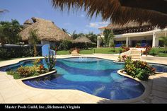 It's like a Caribbean escape in your back yard! add some Ledge Loungers next to bubbler = Heavenly   Master Pools Guild, Inc.
