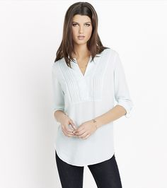 This stunning top features pleated detailing at the collar and back, adjustable sleeves and a hot open collar.