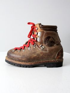 This is a pair of vintage Lowa hiking boots. The German mountain boots feature thick brown leather, chunky soles, and bold red lace ups. A great winter boot for all terrain. Ski Boots, Tall Boots, Brown Leather Ankle Boots, Leather Shoes, Botas Ski, Mountaineering Boots, Boots And Leggings, Hiking Shoes, Fashion Boots