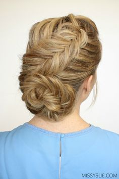 dutch fishtail braid w/ bun... interesting technique to pin along the sides of the braid before stretching it out so the sides don't get too loose!