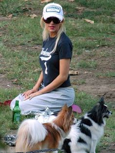 Christina Aguilera with her papillons, Stinky (red & white) and Chewy (black & white).