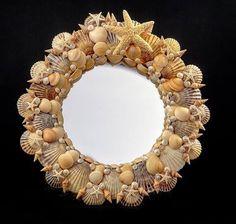 Sea shell round decorative mirror handmade by Cape Cod Shell Design artist, Aimee Guthinger. 2015
