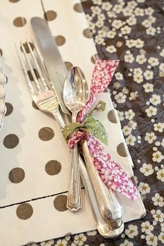 Like the idea of tying utensils in Christmassy fabric or ribbon.