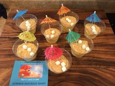 """I made these cup of sand made from vanilla pudding and crushed vanilla wafers.  Then they were dressed up with marshmallows and a drink umbrella to go with our summer birthday theme """"let's do what frozen things do in Summer!!!""""  They were a hit at the birthday party!"""