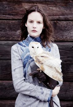 Her bold gaze out stood the surprising golden owl that perched on her arm. He was mesmerized by her stare. Drawn to it.