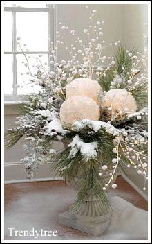 Use real greenery or artificial sprigs,  large ornaments and white pearl picks for this arrangement