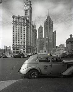 A taxi awaits on Wacker at Michigan, 1944, Chicago.