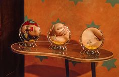 Female nudes partially reflected in a series of small round mirrors, revealing only part of the body in each. They are given the tile, Reflect Upon This