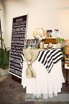 white table cloth layered with geometric fabric and burlap.