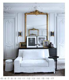 White walls, gilded mirror, ornate plaster molding.  http://victoriaelizabethbarnes.com/