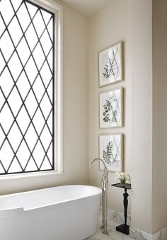 If you don't have the advantage of a private view from your master bathroom, consider using a leaded glass window. Architect Jeffrey Dungan brings his signature look to this bathroom by combining it with an almost modern freestanding bathtub. See other Master Bathtub Ideas. #luxurybathrooms, #traditionalbathroom Bathroom Window Privacy, Bathroom Window Glass, Bathroom Window Coverings, Bathroom Windows, Privacy Glass, Curtains For Bathroom Window, Window Blinds, Master Bathtub Ideas, Master Bathroom