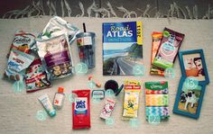 Road Trip Kit- essentials  Map, wet-wipes, sanitiser, snacks, cups with lids, gum, lip balm, band-aids, etc- I would add a first-aid kit- depends where you're going!