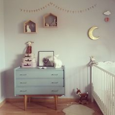 Super cute nursery. Love the simple dresser