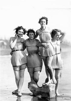 """""""Spruce Girls"""" on beach wearing spruce wood veneer bathing suits during """"Wood…"""