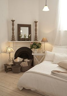 Cosy Shabby Chic, that fireplace would really warm a room up :)