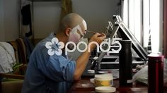 Peking opera actor is painting his face - Stock Footage | by YPPictures