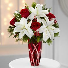 13-C1 Holiday Celebrations Bouquet is a sure fire way to send some holiday cheer to loved ones near and far! This designed red vase with beautifully cut glass down the sides would be just fantastic to use year round! Let H&J Florist and Greenhouses of St Joseph, MI help to bring the spirit of Christmas and the Holidays to life in your home or someone special's! 269-429-3621