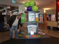 Drug Action Week display with alcocups and drug info @ your library promotional material