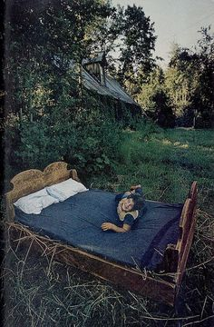 """September 1973, National Geographic: """"Night music of the oudoors - coyotes yapping and crickets chorusing - plays for Mary and Forest Sheehan, grandparents of smiling Jerry Weirton, when they sleep on this suger-pine bed during summers at their isolated ranch near Scales. 'In the tree branches,' says Mr. Sheehan, 'we can see silhouettes of ladies in hoopskirts, witches, and goblins. How much some people miss huddled in their lairs!'"""""""