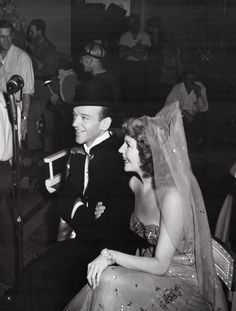 Rita Hayworth and Fred Astaire relaxing behind the scenes of You Were Never Lovelier, c. 1942.