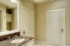 brown marble bathroom, nickel hardware, undermount sink. 6 inch base board, 2 panel doors