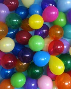 Use painters tape to attach balloons to a wall at your home birthday party and use as a backdrop for pictures of your child and party guests - too bad I got too busy to take many pictures