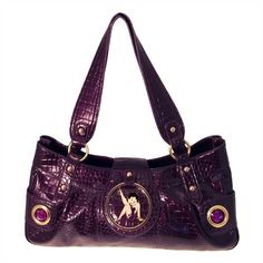 Show off your sassy side with this long handbag featuring Betty Boop. Made from shiny embossed faux leather in a rich purple color, this spacious handbag secures with a zippered closure and clasp. Two