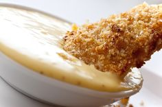 Honey Mustard Chicken Tenders Recipe ~ Tender chicken strips marinated in homemade honey mustard dressing, dredged in bread crumbs and baked until golden... Mmmm!
