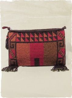 Chimu Pima Cotton Clutch with tribal graphics in vibrant shades of rust, persimmon and cherry red , with beaded fringe accents.