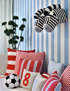 Delightful red and blue boy's bedroom with white and blue striped walls displaying wall-mount fabric zebra heads over a charming day bed filled with soccer ball pillow and collection of red gingham pillows and red stripe pillows. Childrens Room Decor, Kids Decor, Striped Walls, Kids Corner, Cool Rooms, Kid Rooms, Contemporary Bedroom, Pillow Design, Boy Room
