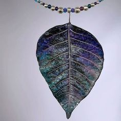 Necklace made with a porcelain leaf, molded on real poinsettia leaf, one of a kind, handmade in Switzerland.  http://www.ilemas.ch/en/