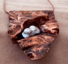 is formfolded scrap copper with an unusual fresh water pearl wired into it Ceramic Jewelry, Enamel Jewelry, Copper Jewelry, Wire Jewelry, Pendant Jewelry, Jewelry Crafts, Handmade Jewelry, Jewlery, Metal Embossing
