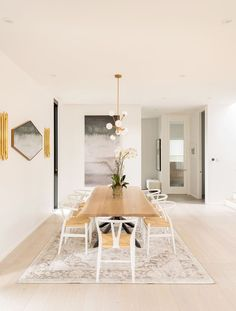 """Kleinberg opted out of a formal dining room and """"went for what is essentially one massive room with 10-foot-high ceilings"""" instead. """"It's cool because both doors on the first floor run the length..."""